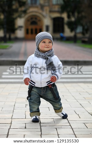 Cute little boy outdoors - stock photo