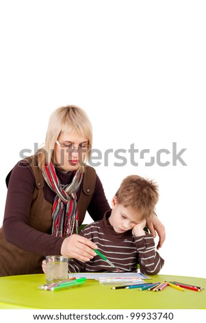 cute little boy painting with his mother - stock photo