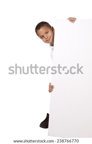 Cute little Boy peeking behind a blank sign - stock photo