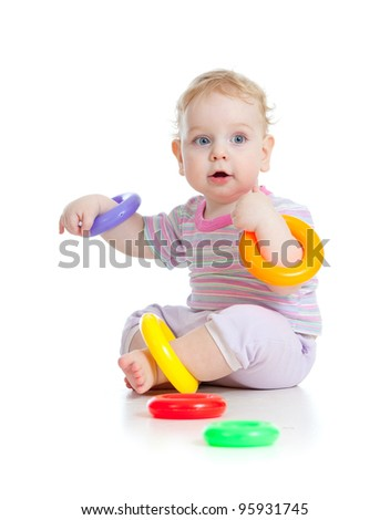 Cute little boy playing colorful toys isolated on white - stock photo