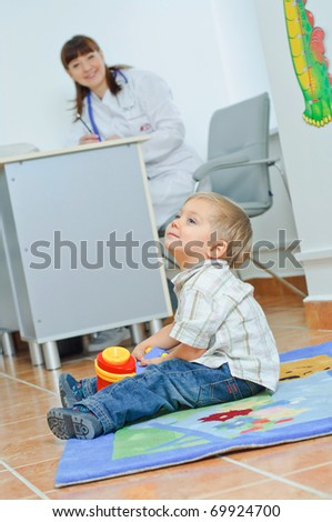 Cute little boy playing in the pediatrician's office