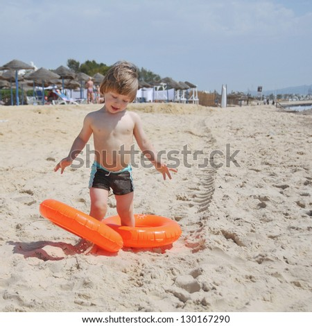 Cute little boy playing on the beach