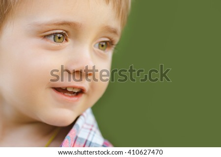 Cute little boy playing outdoor on the nature. Close-up portrait - stock photo