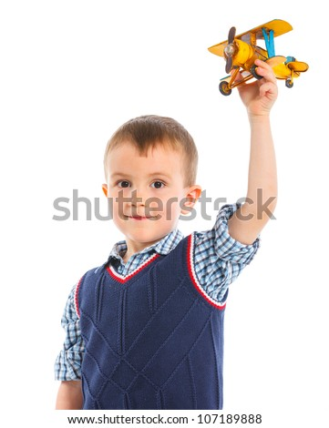 Cute little boy playing with a toy airplane. Isolated on white background