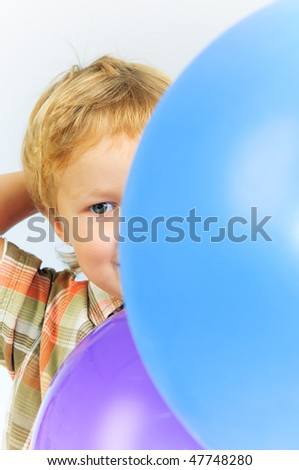 Cute little boy playing with balloons