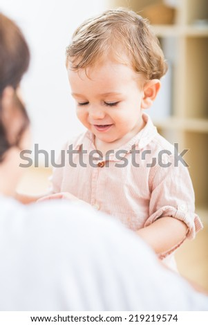 Cute little boy playing with numbers and sticks at the nursery school