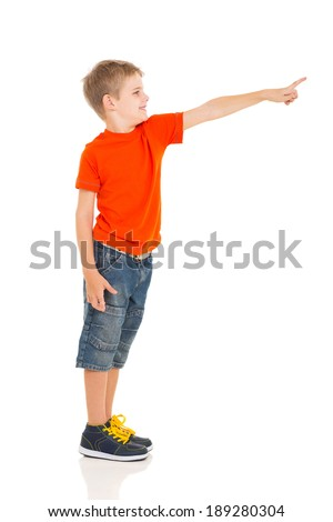 cute little boy pointing copy space isolated on white background - stock photo