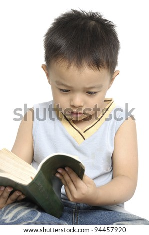 cute little boy reading a book, isolated - stock photo