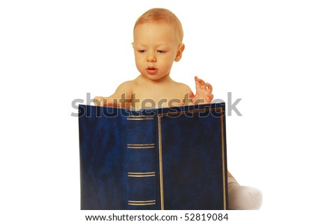 cute little boy reading a book isolated on white background