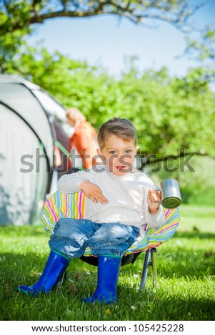 Cute little boy resting in camping great outdoors