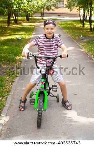 cute little boy riding the bicycle