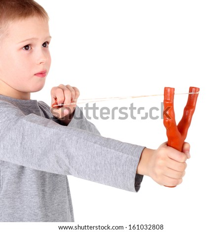 cute little boy shooting from a slingshot