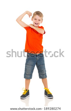 cute little boy showing off his biceps flexing his arm - stock photo
