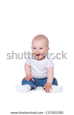 cute little boy sitting on the floor and smiling. isolated on white background