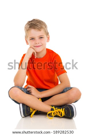 cute little boy sitting on white background - stock photo