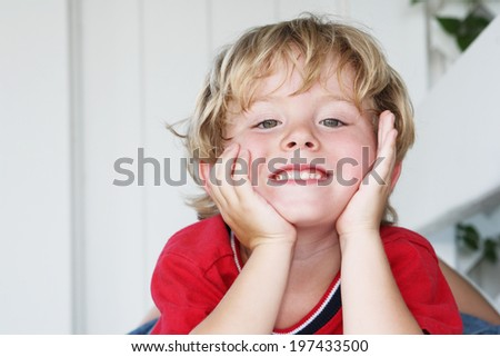 Cute little boy smiling - stock photo