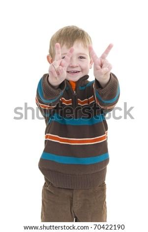 Cute little boy spreads Peace, Love & Joy - stock photo