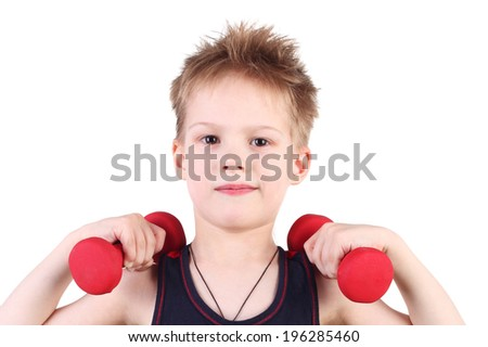 cute little boy training with the dumbbells - stock photo