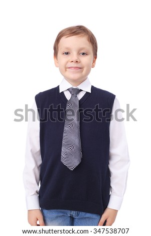 cute little boy wearing white shirt and blue vest with the necktie