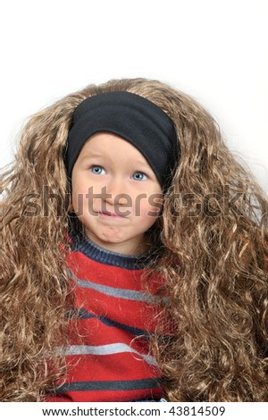 cute little boy wearing wig