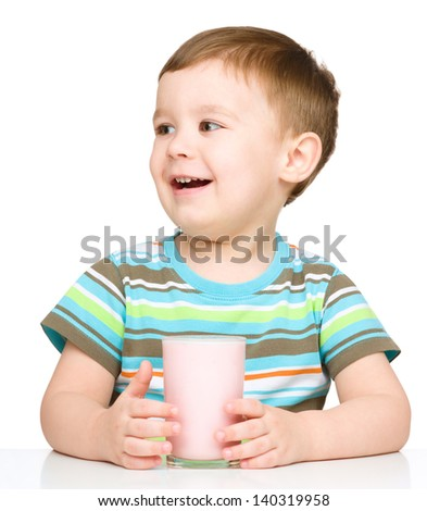 Cute little boy with a glass of milk, isolated over white - stock photo