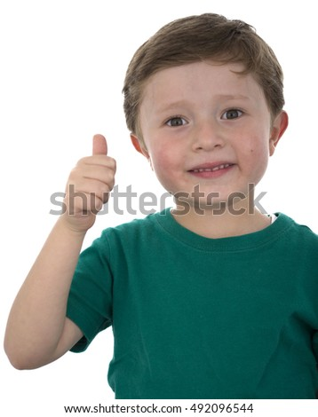 Cute little boy with a thumbs up.