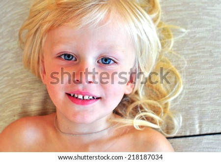 Cute little boy with blonde hair - stock photo
