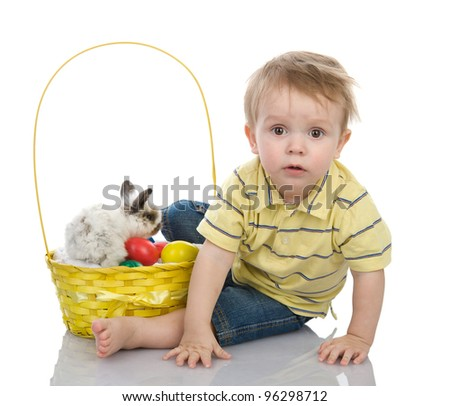 Cute little boy with Bunny and Easter eggs in yellow basket.  isolated on white background