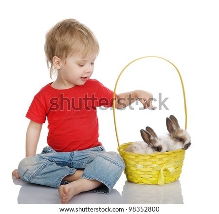 Cute little boy with Easter rabbit in yellow basket. isolated on white background - stock photo