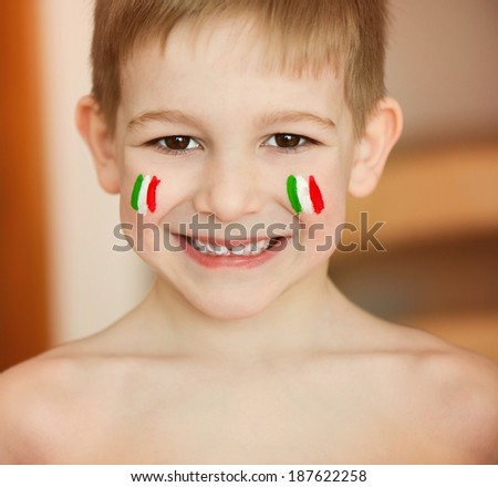 Cute little boy with European flags on cheeks