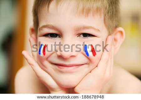 Cute little boy with European flags on cheeks - stock photo