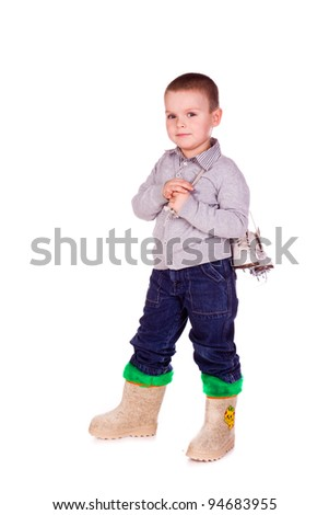 Cute little boy with figure skated isolated over white backgound