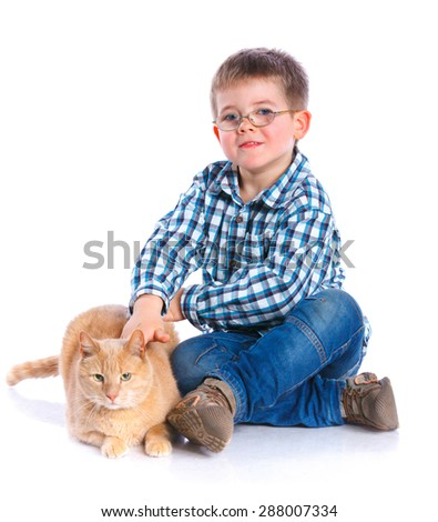 Cute little boy with his red cat smiling at camera on isolated white background - stock photo