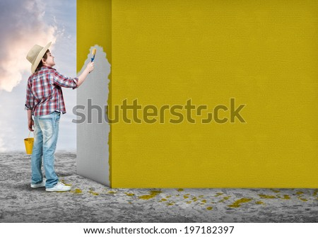 Cute little boy with paint brush in hand