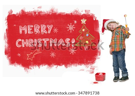 Cute little boy with Santa hat painting red Marry Christmas banner on the wall isolated on white backgroundS