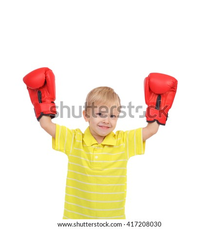 cute little boy with the box gloves - stock photo