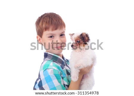 cute little boy with the cute little puppy - stock photo