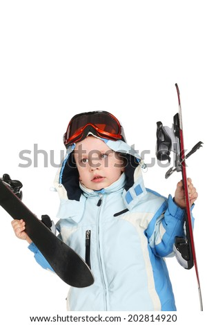 cute little boy with the skis in his hands - stock photo