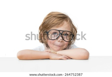 Cute little boy with toy glasses isolated on white background