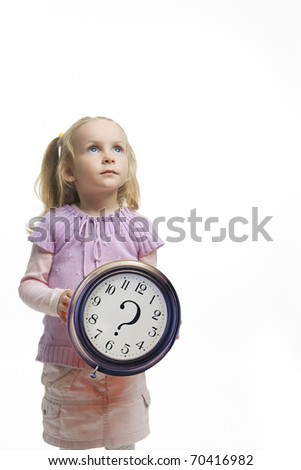 cute little caucasian blond girl holding big clock in front and thinking, isolated over white background