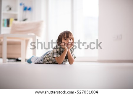 Cute little child at beautiful modern home