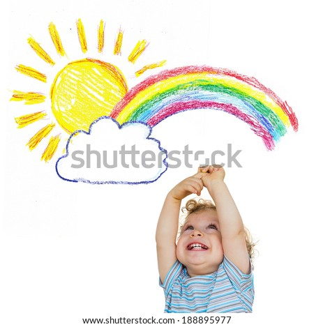Cute little child holds arms out to the sun and the rainbow