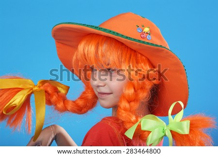 cute little child in a special costume of a Pippi Longstocking