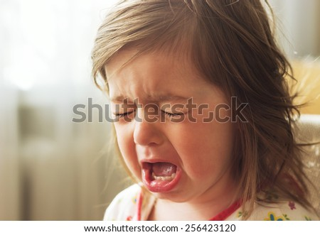 Cute little child is crying - stock photo