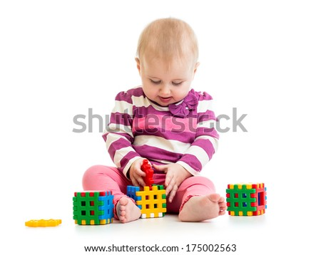 Cute little child is playing with toys