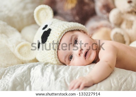 Cute little child laying on the couch - stock photo