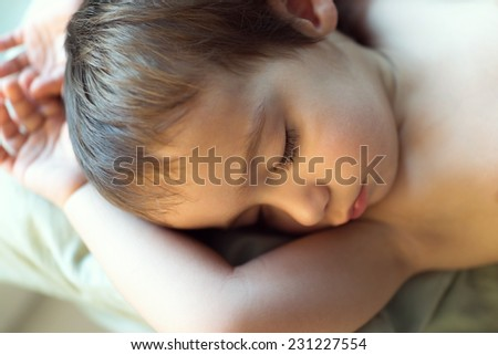 Cute little child sleeping on bed
