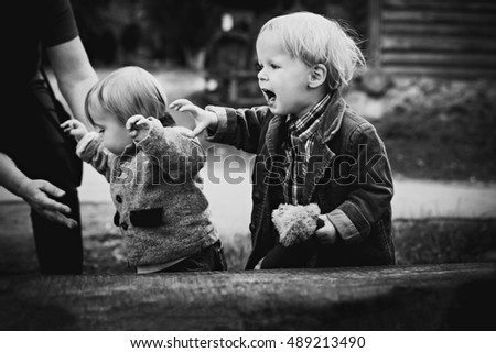 Cute little children outside b&w