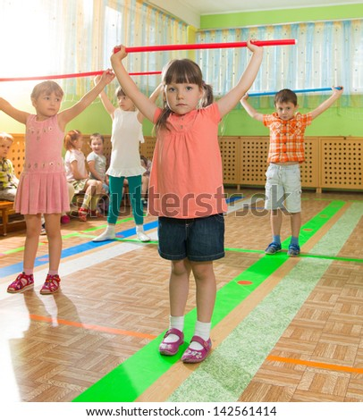Cute little children playing at daycare gym - stock photo