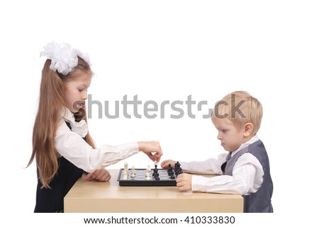 cute little children playing chess - stock photo